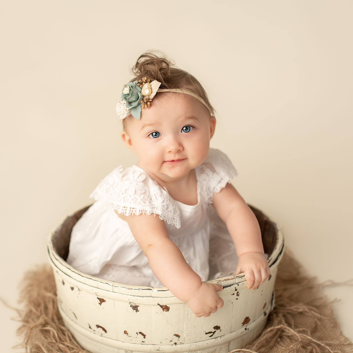 baby girl sitting in bucket for sitter session in pembroke pines, fl