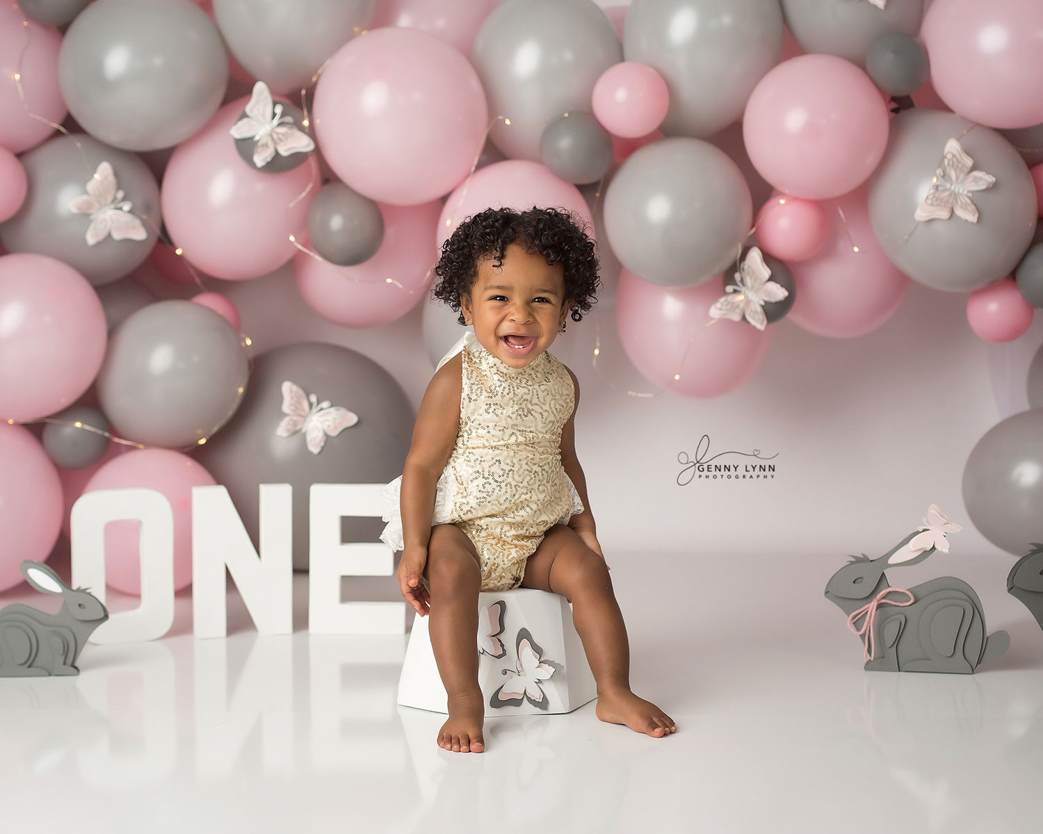 one year old girl sitting for first birthday photos in cooper city, FL