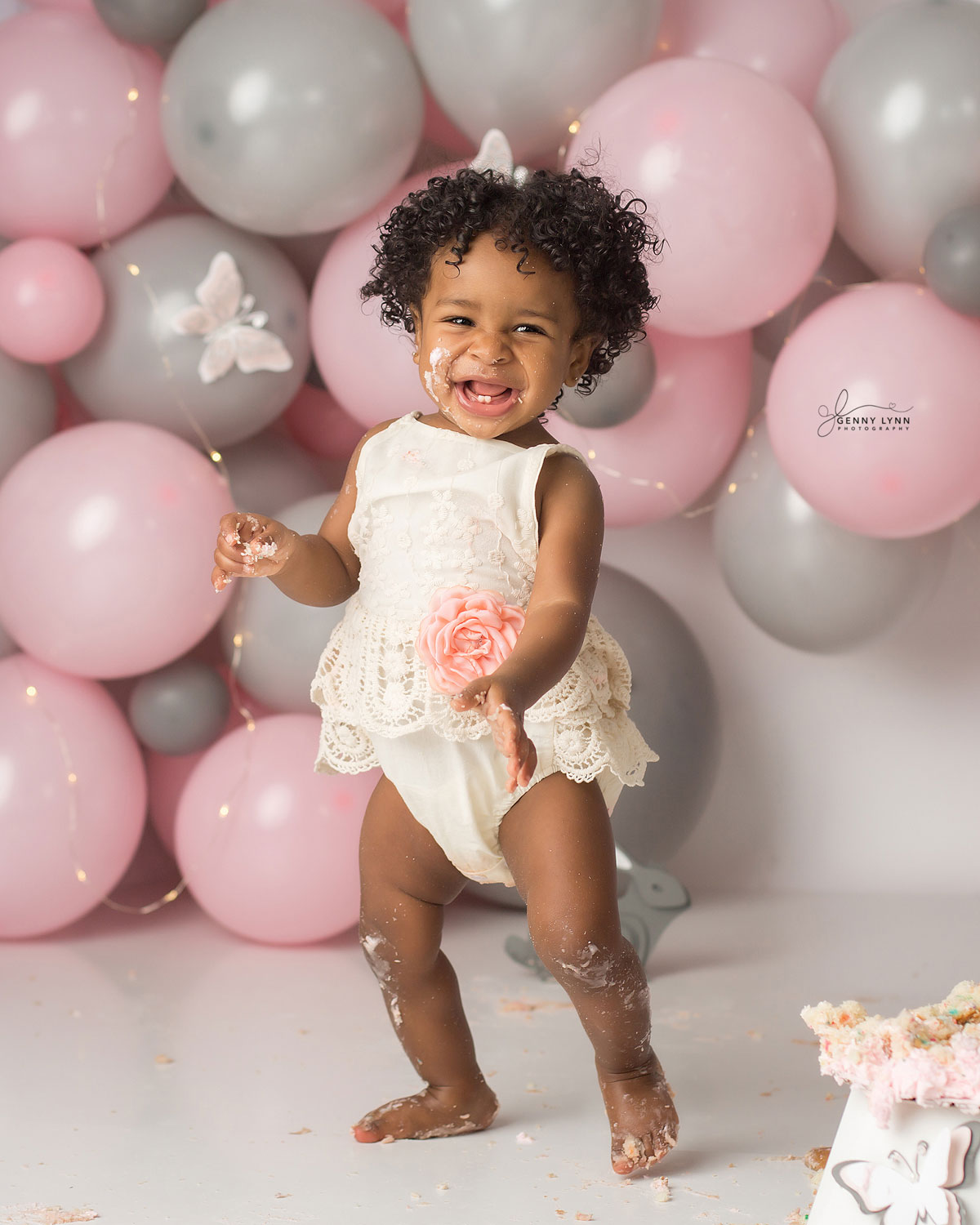 baby girl walking at first birthday session in cooper city, fl