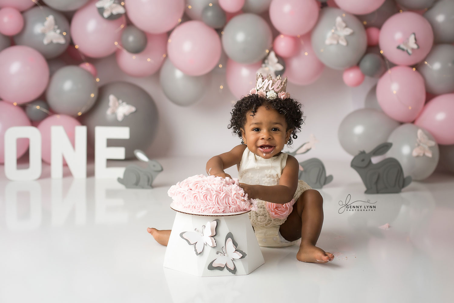 baby girl smiling with her first birthday cake smash in hollywood, fl