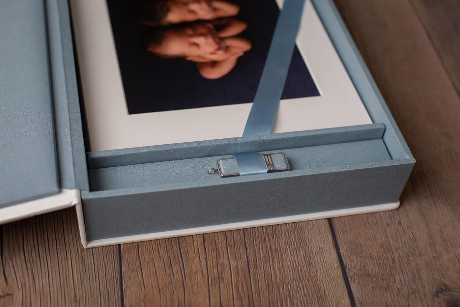 folio box with maternity and newborn photos