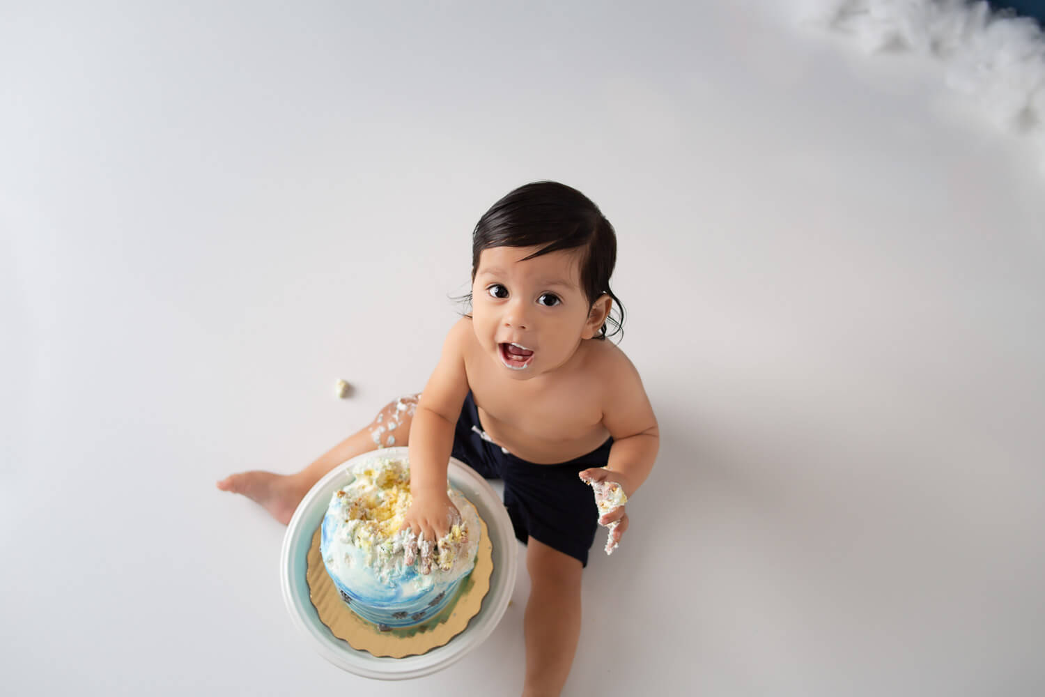 baby eating cake smash photo