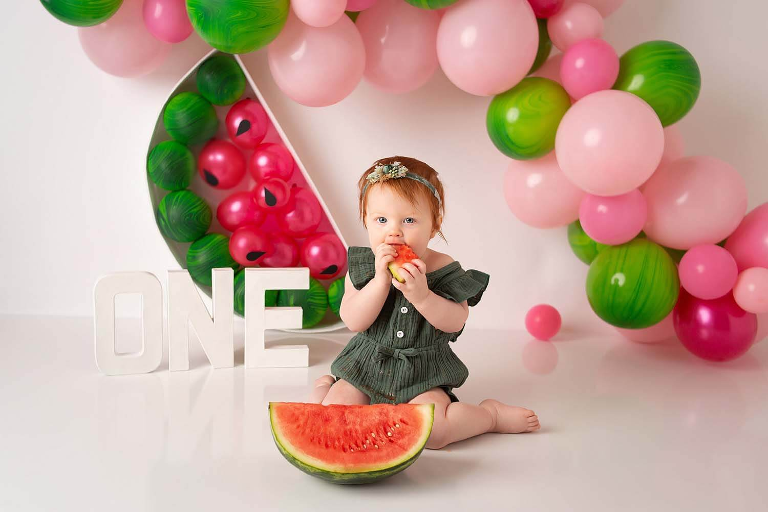 one year baby eating watermelon cake smash photoshoot