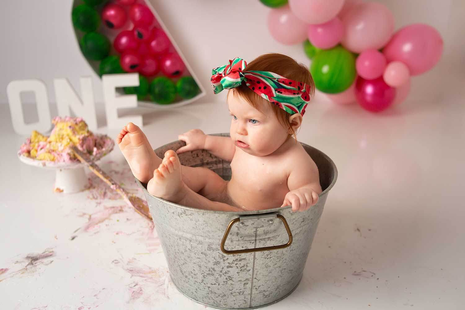 one year baby watermelon cake smash photoshoot in bucket