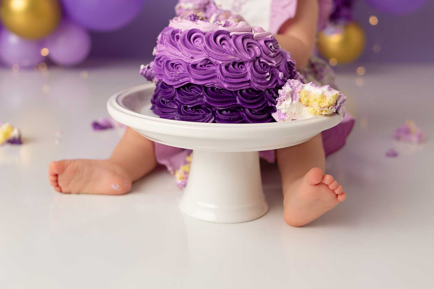 one year old baby eating cake for smash cake session