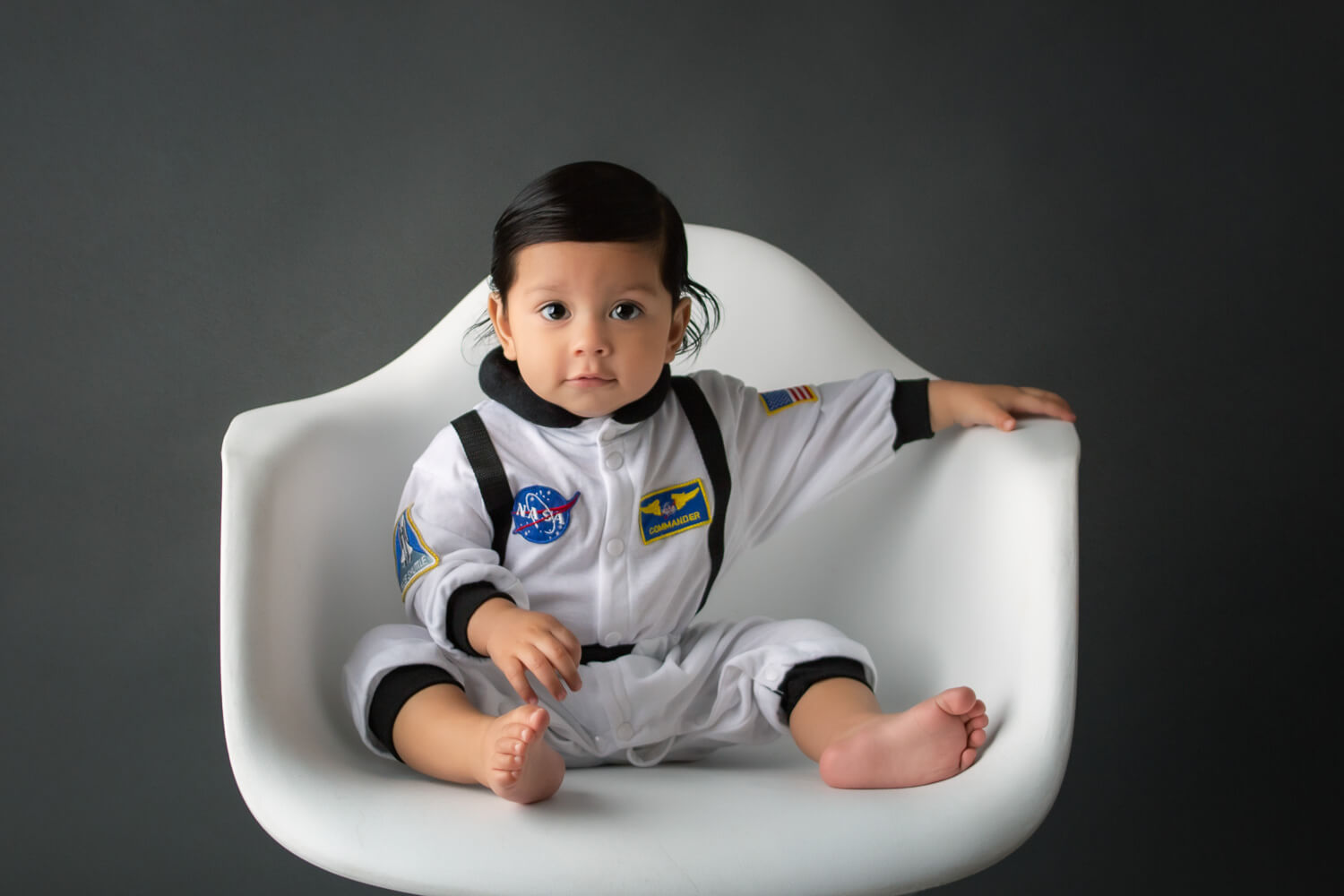 one year old in chair photoshoot