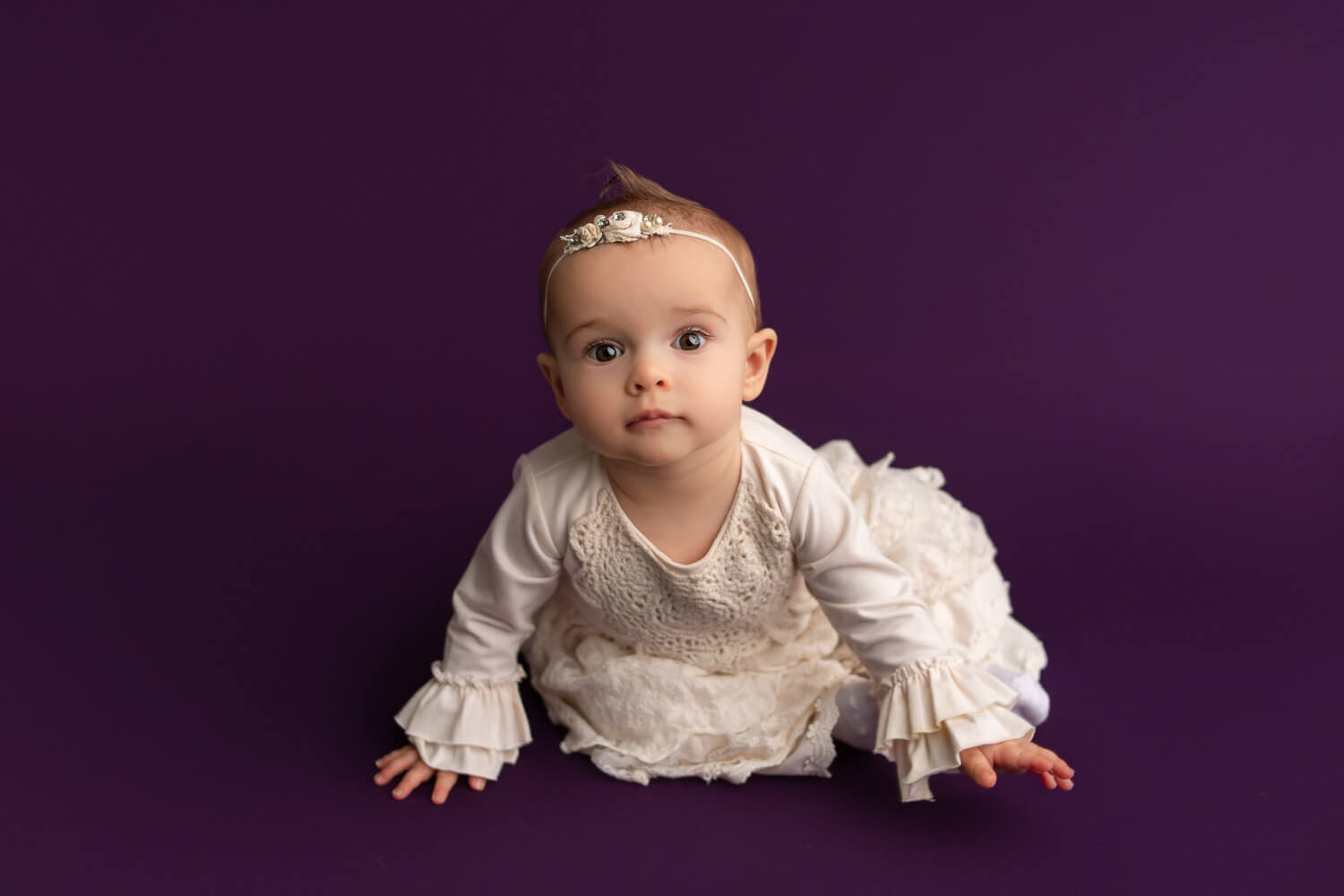 one year old on purple backdrop photoshoot