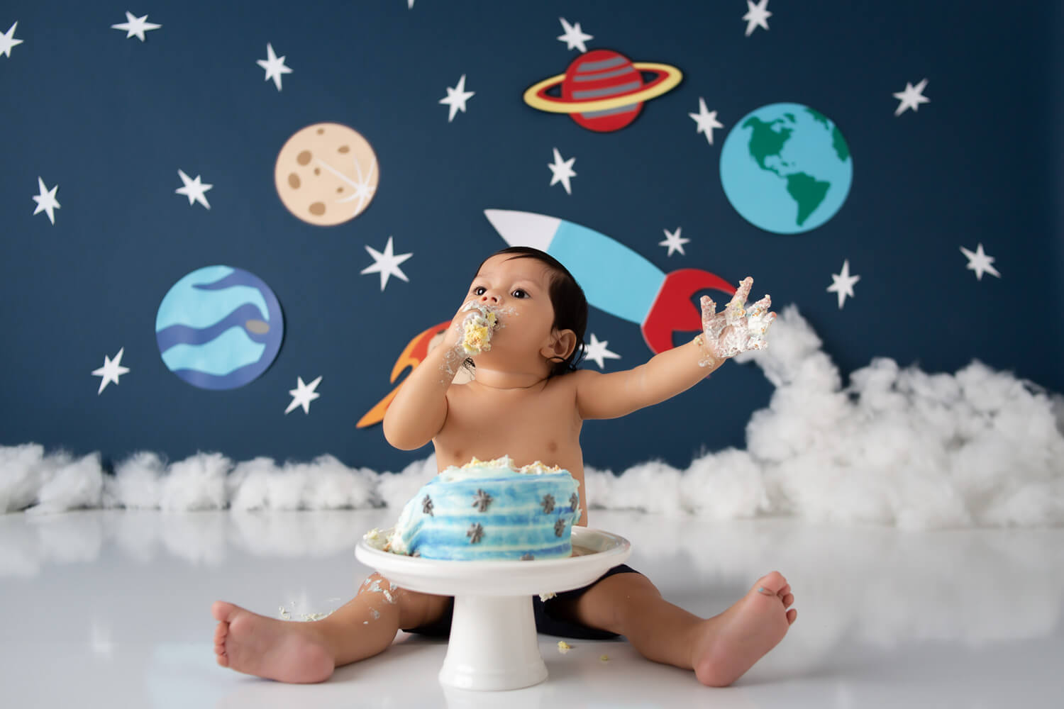 one year old outer space cake smash photoshoot