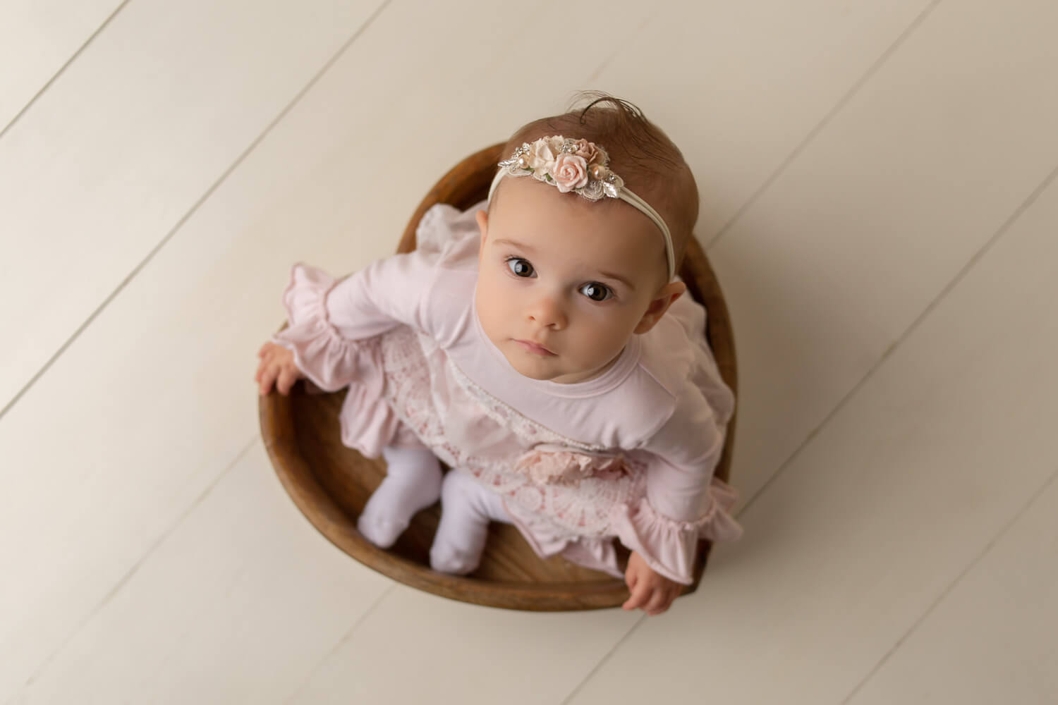 one year old sitting in heart bowl photoshoot
