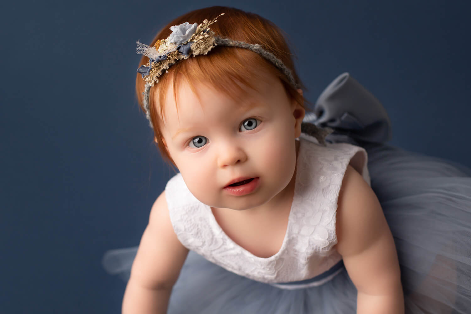 red hair blue eye baby photoshoot