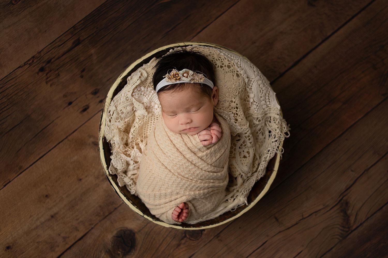 newborn-girl-in-a-bucket