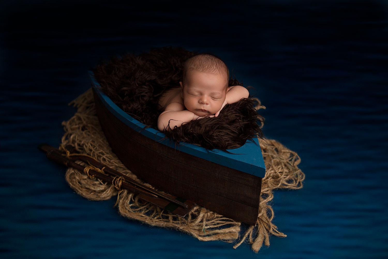 newborn-sleeping-on-a-boat